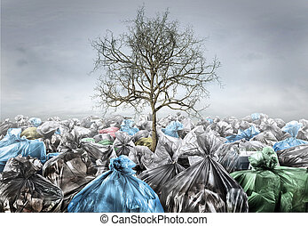 Pollution concept. Dead tree in area full of trash on a ...