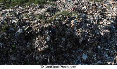 Pollution concept. Garbage pile in trash dump or landfill....
