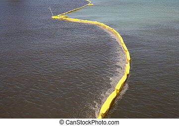 Pollution control barrier in the sea viewed from the city pier Anna maria island florida united states usa taken in march 2006