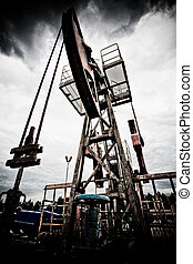 Pollution from fossil fuel and global warming - Oil rig pump...