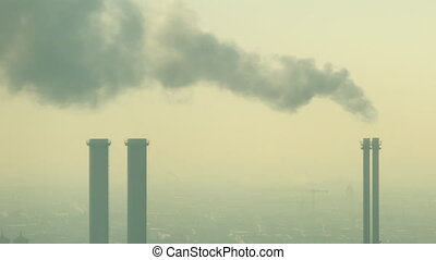 Pollution from industrial factory chimneys on the skyline of Berlin, Germany