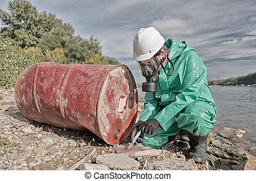 Pollution inspector - Environmentalist taking sample at...