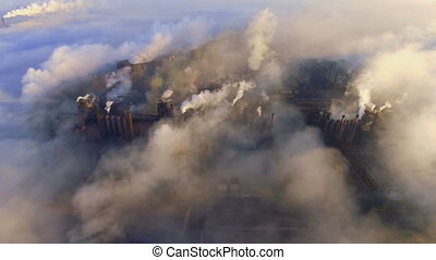 Pollution of the environment: a pipe with smoke. Industrial...