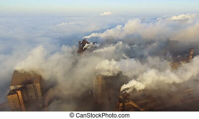 Pollution of the environment: a pipe with smoke. Industrial zone. Aerial view