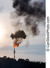 Pollution - oil reinery Distillation tower with smoke stack...