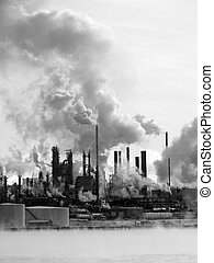 pollution - Oil refinery on a cold day. Taken in black and...