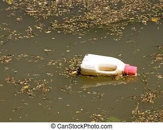 Plastic bottle in a river water