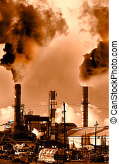 Pollution - Menacing fumes arising from the smokestacks of...