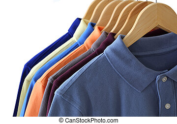 Polo Shirts - Front view of polo shirts on hanger isolated...