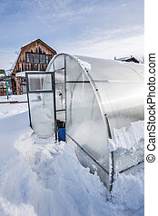 Polycarbonate greenhouse in winter. Western Siberia - Snow ...