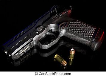 Polymer handgun - Black handgun with a polymer frame on a...