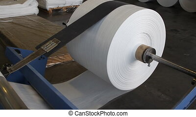 polymeric tape roll unreel for a printing press