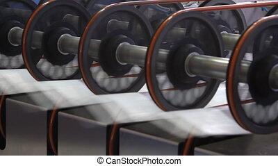 polymeric tape roll unreel for a printing press - Big...