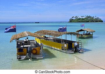 Landscape view Polynesian boats mooring on Muri lagoon in Rarotonga, Cook Islands.