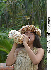 Polynesian Cook Islander woman blowing conch shell in ...