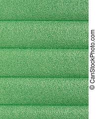 Green soft polypropylene pillow useful as a background