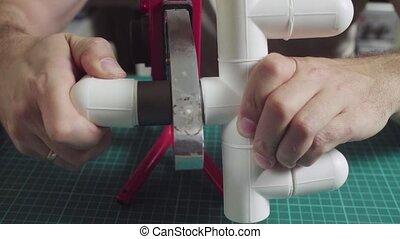 Polypropylene pipes welding, man's hands working - Crane ...