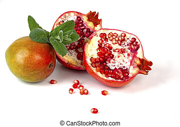 pomegranate and mango on a white background