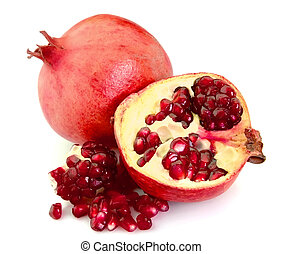 Pomegranate fruit and grains closeup