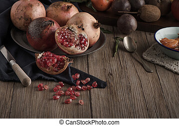 Pomegranate fruit on rustic table