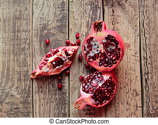 Pomegranate fruit on wooden table