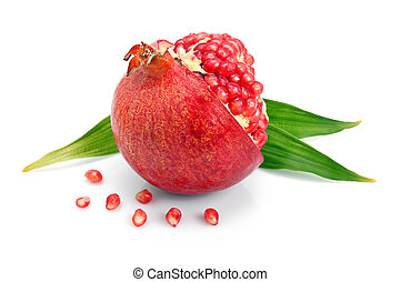 Pomegranate fruit with green leaf and cuts isolated