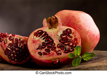 Pomegranate in poor art style - photo of sliced pomegranate...