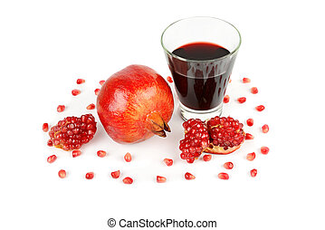 Pomegranate juice in a glass and ripe pomegranates. Isolated on white background