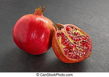 Pomegranate on a slate plate