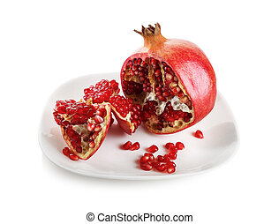 Pomegranate on a white plate.