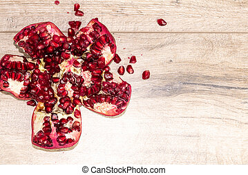 Pomegranate on a wooden table