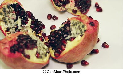 Pomegranate rotation on the table, close-up
