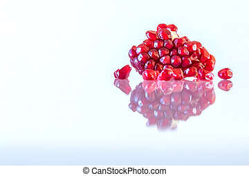 pomegranate seeds on white background