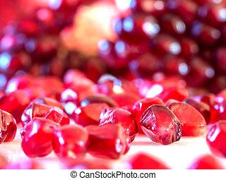 pomegranate seeds on white background