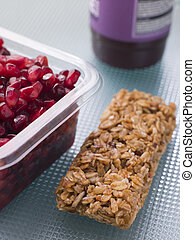 Pomegranate Seeds With A Cereal Bar And Berry Smoothie
