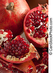 Pomegranate slices and seeds on silver salver