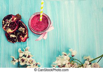 Pomegranate smoothie on blue background