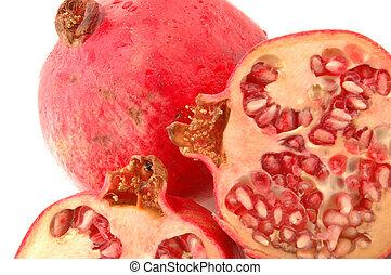 pomegranate three - fresh healthy pomegranates with one cut...