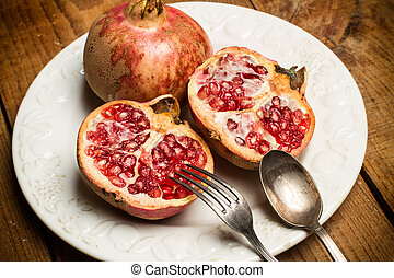 Pomegranates on a white plate
