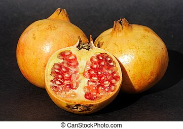 Pomegranates. - Pomegranates against a black background.