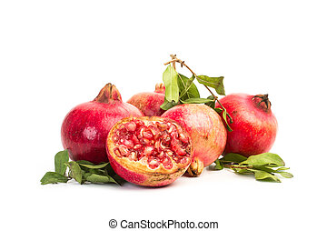 Pomegranates with branches and leaves on a white background