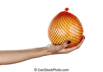 pomelo fruit in hand