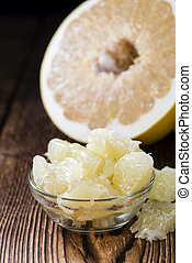 Pomelo Fruit - Pieces of a fresh Pomelo Fruit on wooden...
