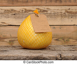 Pomelo fruit with blank price tag wrapped in a plastic