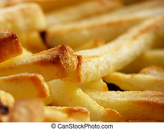 pommes frites - Close-up of oily french fries as a ...