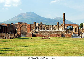 View of the Pompei ruins in italy with Mount Vesuvius in background.