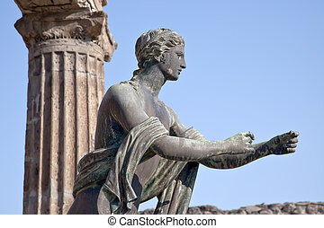 Pompeii. Statue of Apollo - Remains enormous destroyed by a...
