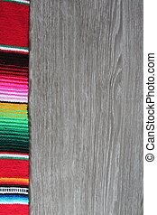 poncho serape background Mexican cinco de mayo fiesta wooden copy space
