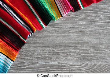 poncho serape background Mexican cinco de mayo fiesta wooden copy space