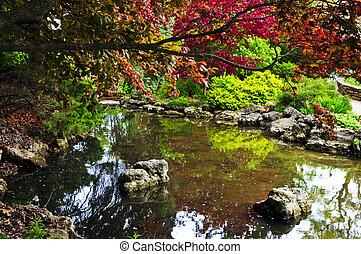 Pond in zen garden - Pond with natural stones in japanese...